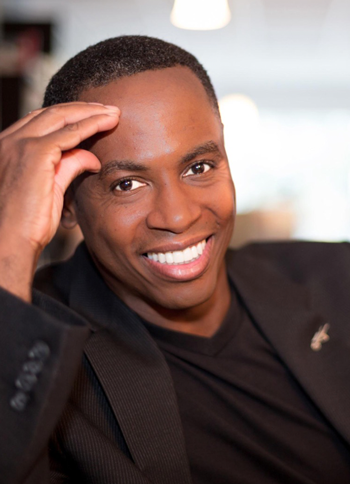 Dr. Adolph Brown headshot in a black suit